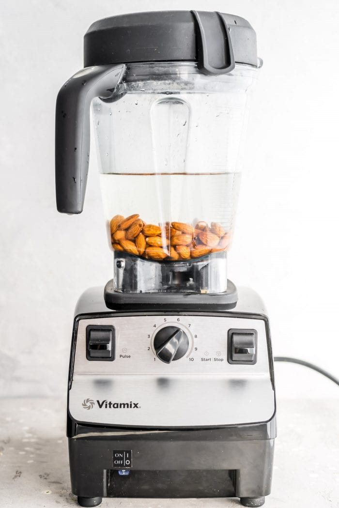 Water and almonds in a Vitamix blender.