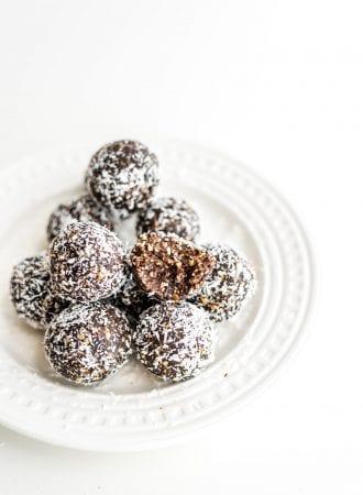 Easy, healthy, no-bake raw vegan hazelnut truffles on a white plate.