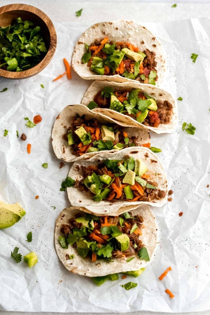 Healthy vegan lentil tacos with avocado and veggies.