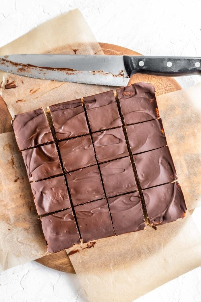 Overhead shot of sliced chocolate coconut bars sliced into 16 pieces.
