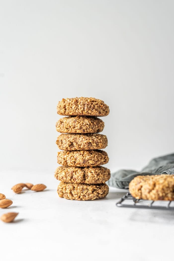 A stack of vegan coconut almond date cookies.
