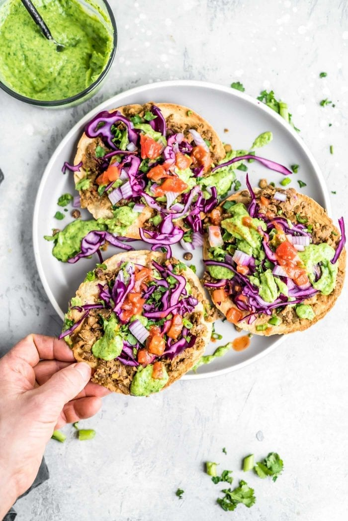 Vegan Lentil Tostadas Recipe with Avocado Cilantro Sauce - Running on Real Food