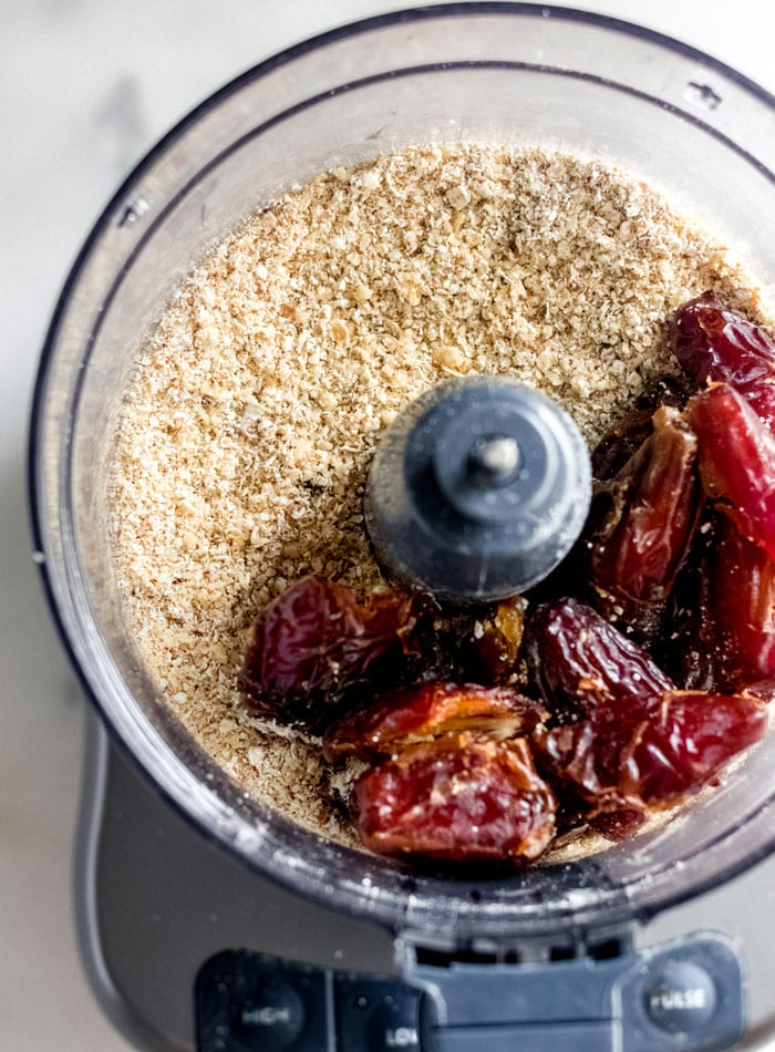 Dates and almond flour in a food processor.