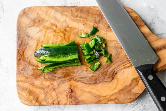 Diced jalapeno on a chopping board.