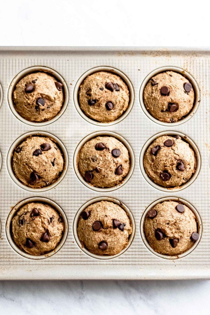Baked banana muffins in a muffin baking tray.