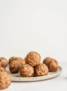 A stack of energy balls on a plate.