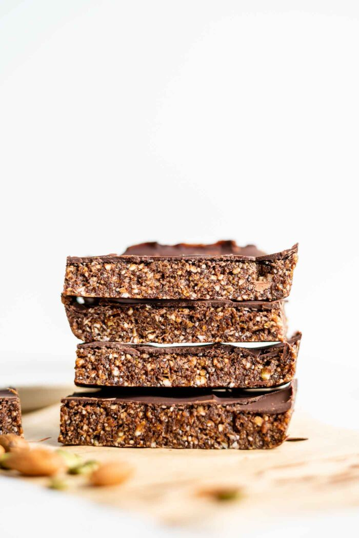 A stack of 4 large energy bars sitting on parchment paper.