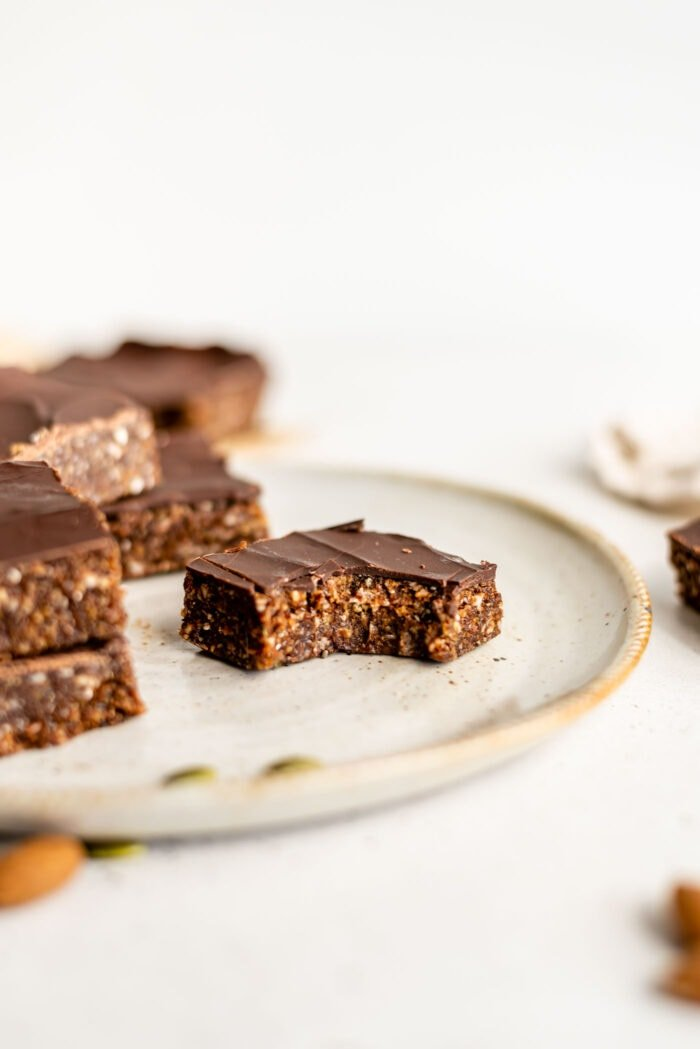 An energy bar on a plate with a bit taken out of it.