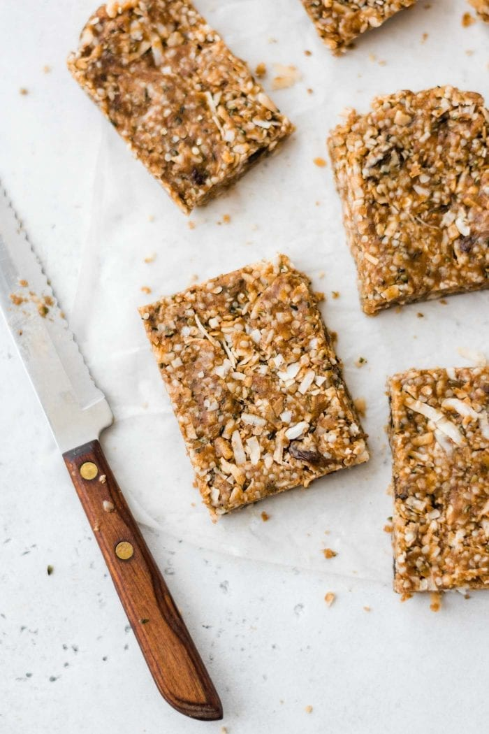 Sliced paleo bars lying on a piece of parchment paper.