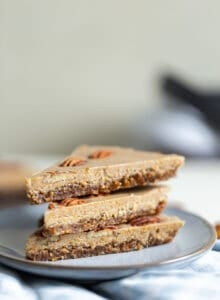 3 slices of raw vegan maple pecan pie on a small grey plate.