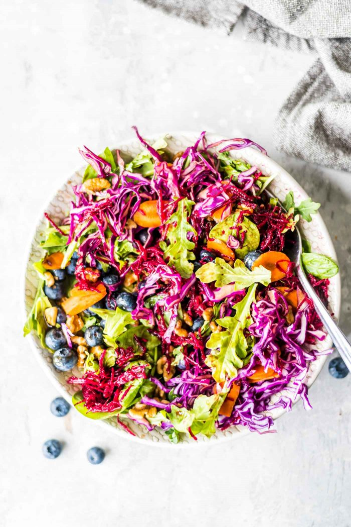 Mixed up beet walnut salad with carrot, arugula, cabbage and balsamic dressing.