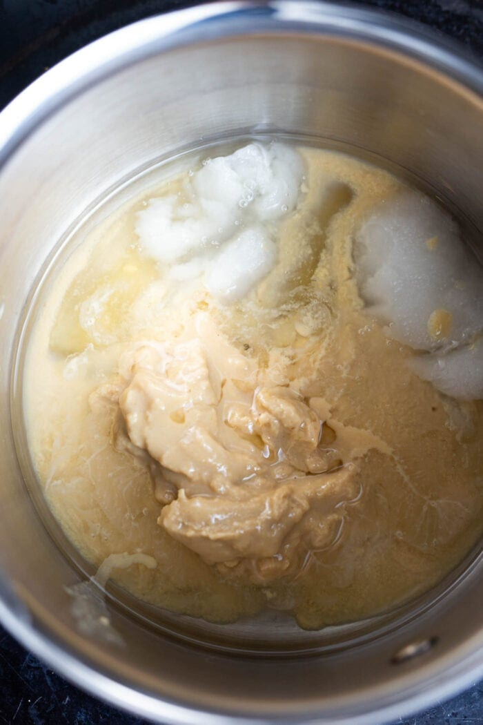 Tahini and coconut oil in a metal mixing bowl