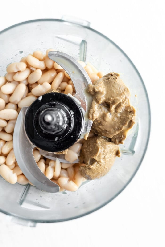 Beans and nut butter in a food processor.