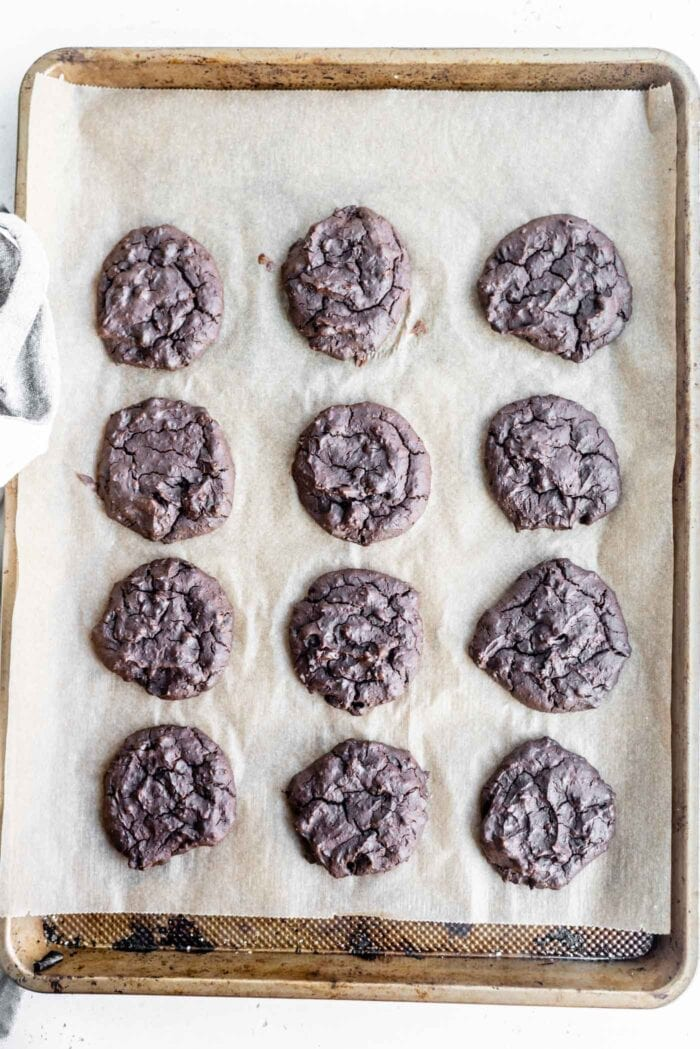 Baked chocolate cookies on a baking tray.