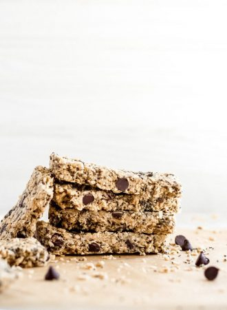 Stack of 4 chocolate chip oatmeal bars, another resting up against them.