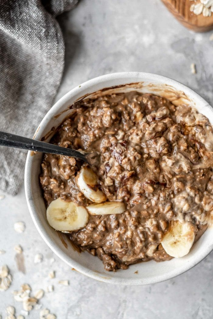 Bowl of mocha oatmeal with banana.