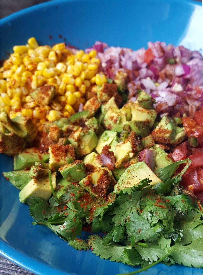 Vegan Burrito Bowls with Chimmichurri Sauce and Avocado Corn Salsa