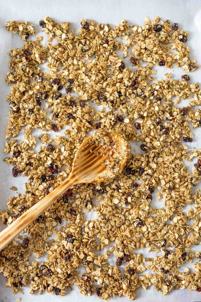 Granola spread on a baking tray.