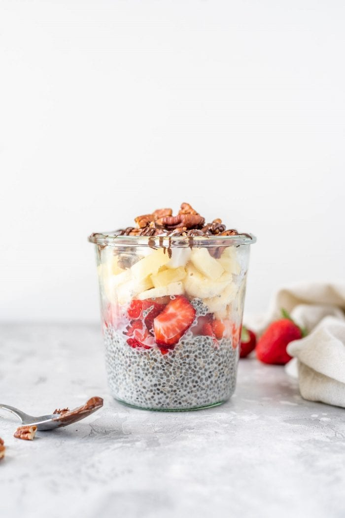 Vanilla chia seed pudding topped with fresh fruit and pecans.