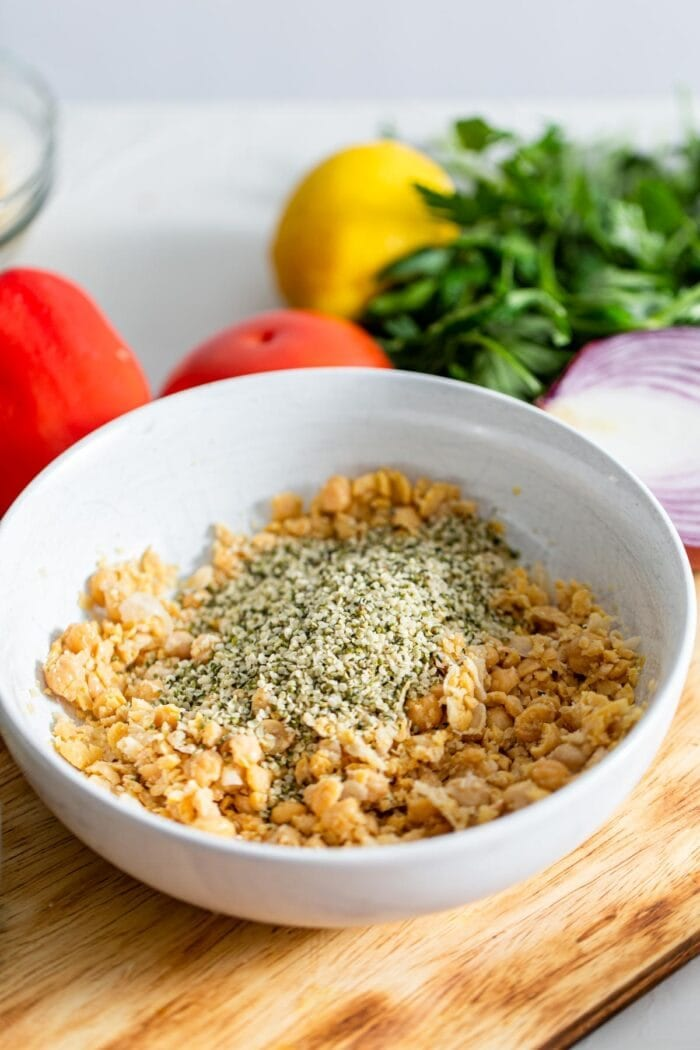 Hemp seeds and mashed chickpeas in a bowl.