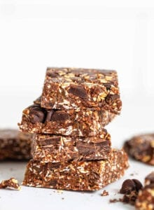 A stack of chocolate bars with chocolate chunks in them.