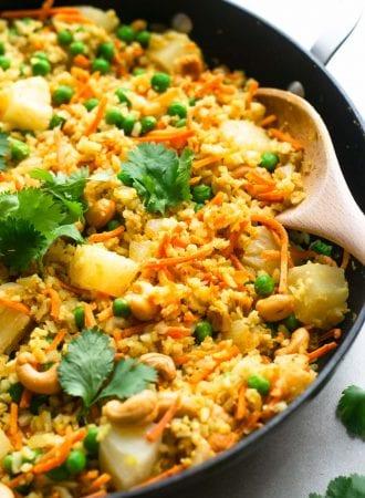 Healthy vegan pineapple cauliflower rice with cashews.