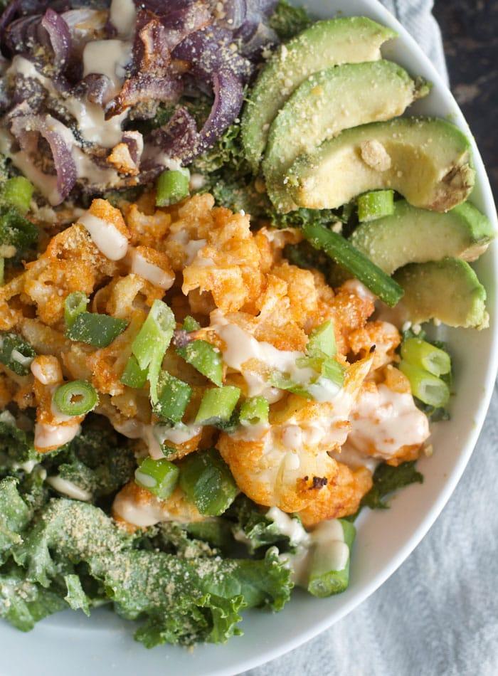 Buffalo Cauliflower Kale Salad with Avocado, Tahini and Vegan Parmesan   healthy, vegan and gluten-free