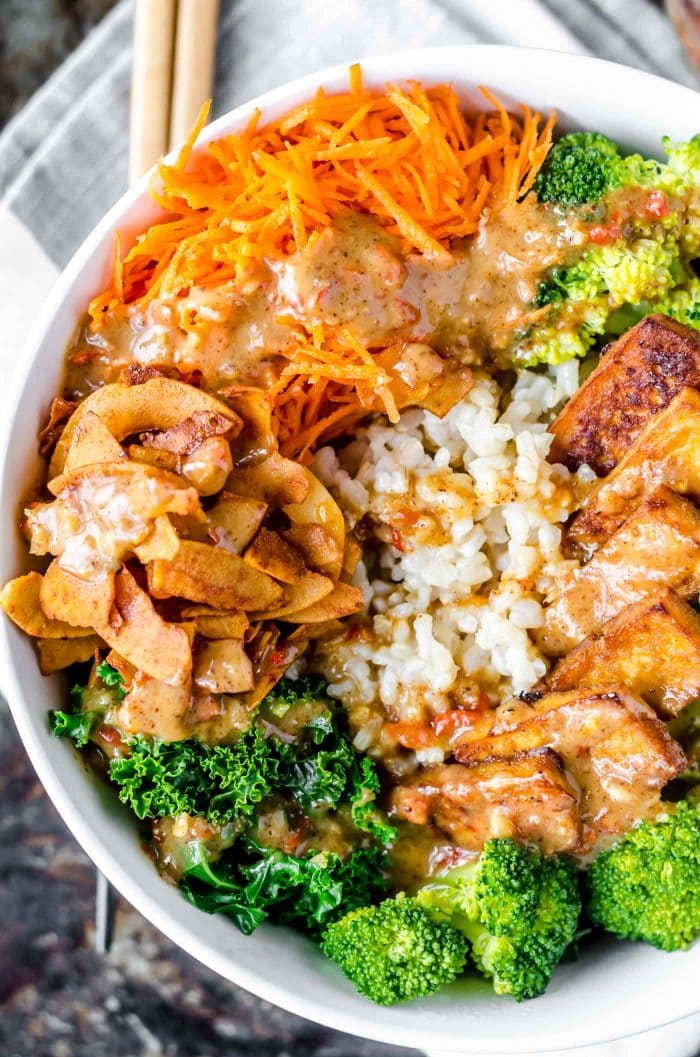 Coconut bacon with broccoli and brown rice in a vegan buddha bowl.