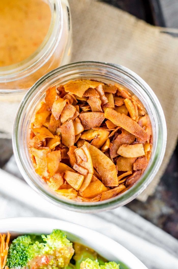 Easy vegan coconut bacon in a glass jar.