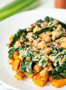 A plate of vegan kale chickpea stir fry with miso peanut sauce.