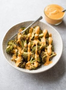 Crispy Cheesy Roasted Broccoli wth Vegan Cheese Sauce