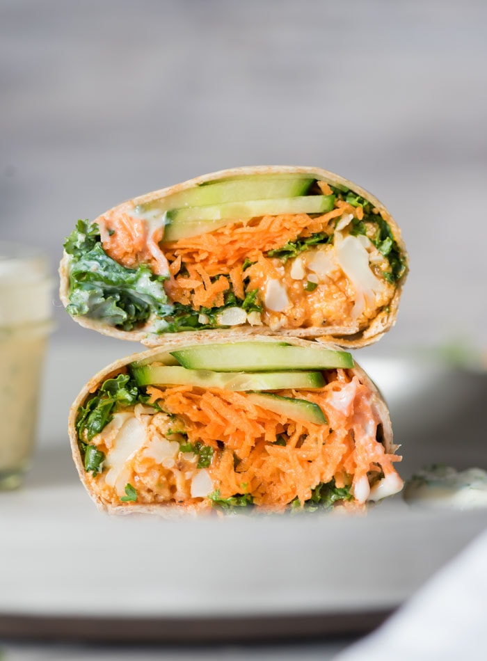 Cauliflower Buffalo Bites wrapped in a tortilla with kale, avocado and vegan ranch dressing.