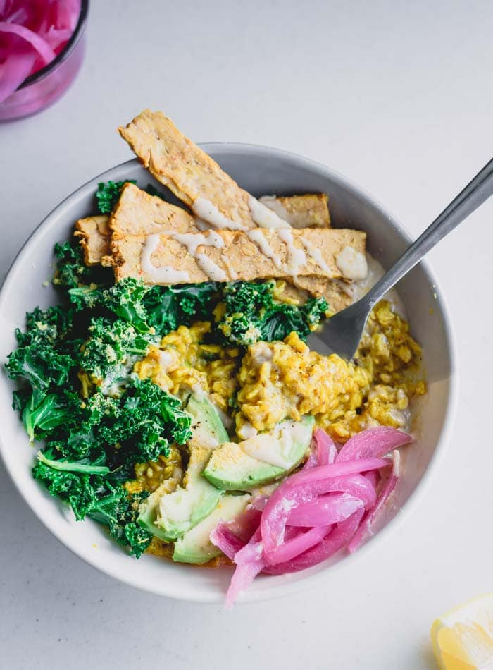 Healthy Savory Oatmeal Bowl with Tempeh, Kale and Tahini