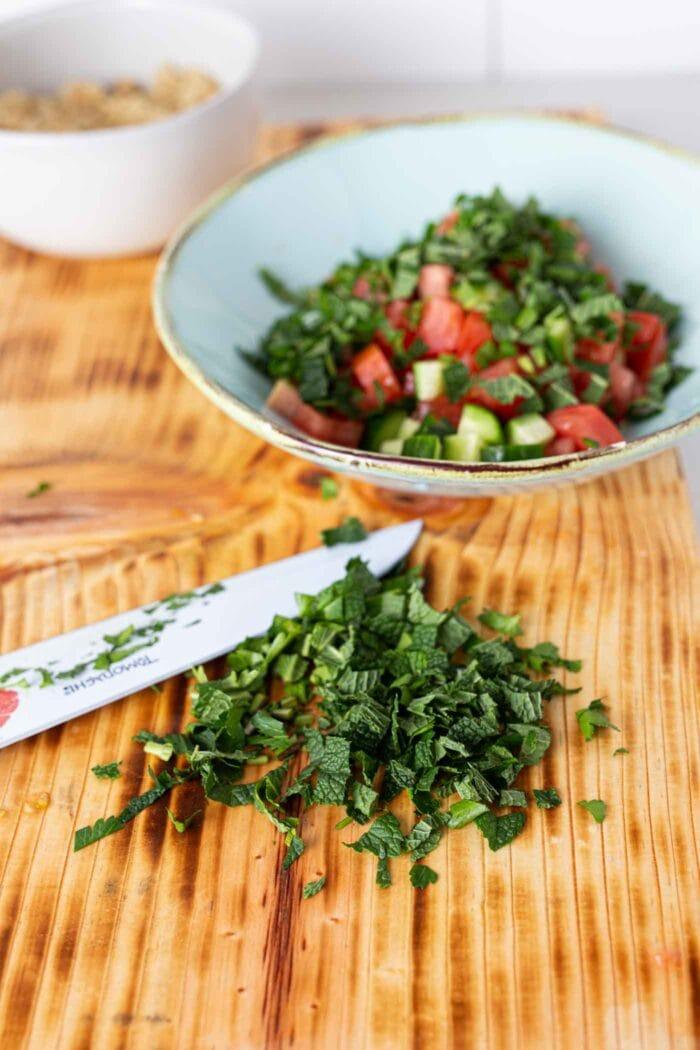 Chopped parsley on a cutting board.