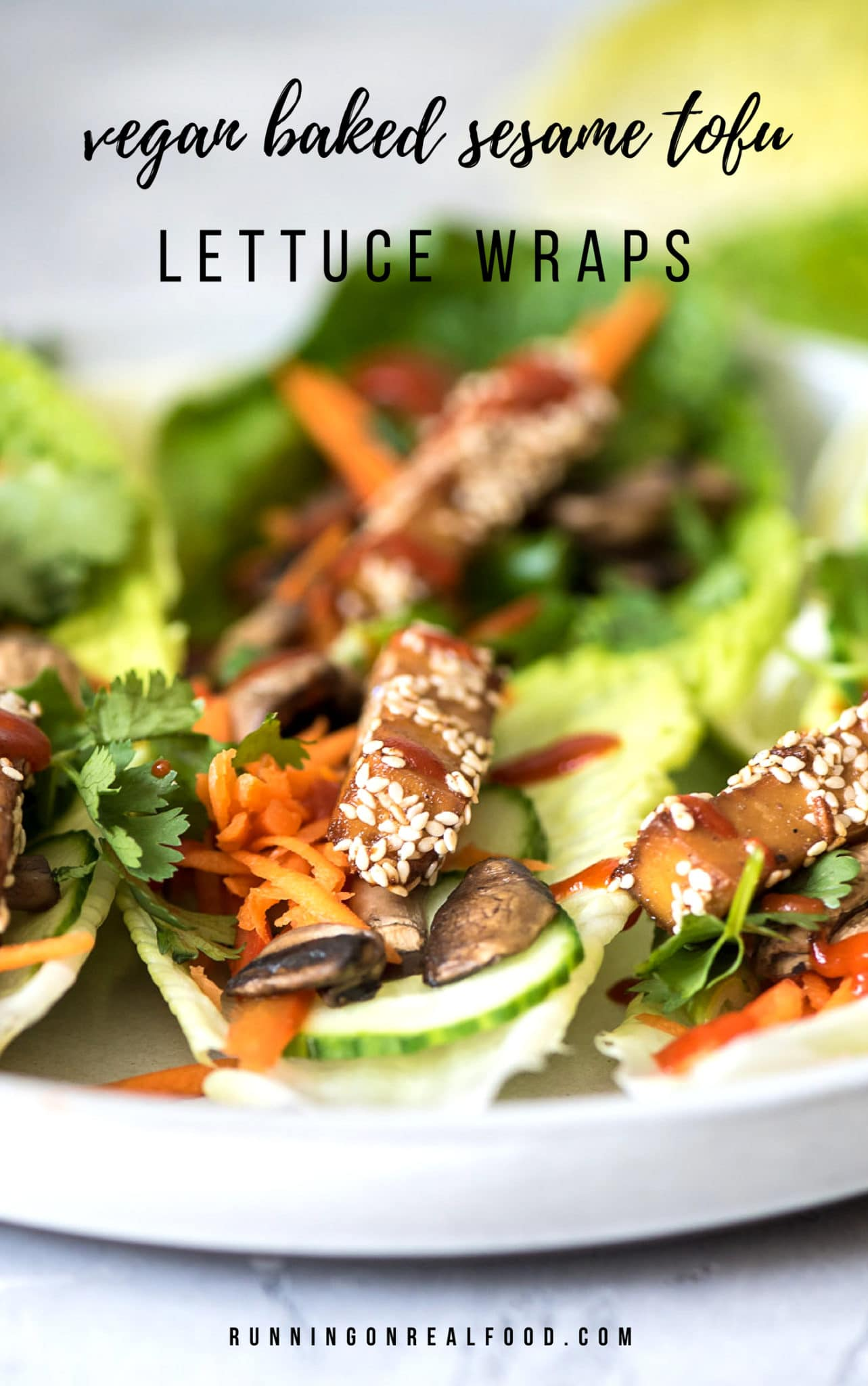 Delicious vegan sesame baked tofu piled into lettuce wraps with sautéed mushrooms, avocado, carrot, green onion, cucumber, cilantro and sriracha. Try these for an easy, healthy plant-based dinner! The leftovers make a great salad too. Try adding almond pad thai sauce for more flavour!#vegan #veganrecipes #veganfood #tofurecipes #tofu #lettucewraps #healthydinners #vegandinners #recipes #dinnerideas #grainfree #glutenfree #plantbased #bakedtofu #sesametofu