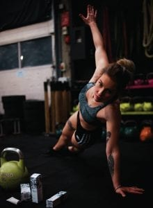 Fit young woman doing a side plank.
