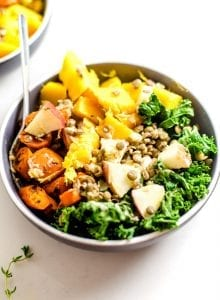 Fall buddha bowl with kale, apple, squash and carrot.