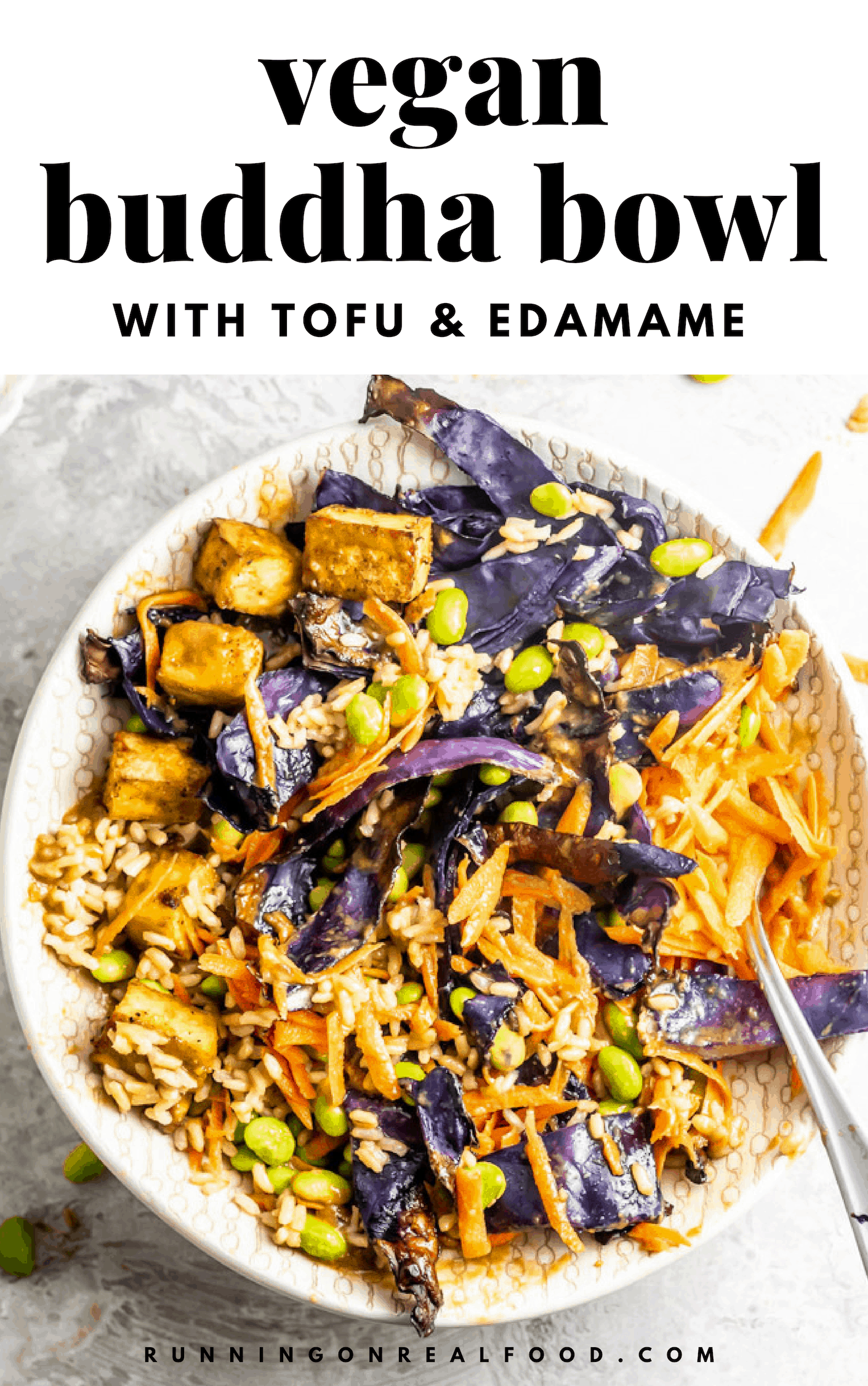 A healthy, filling vegan buddha bowl featuring tofu, edamame, brown rice, roasted cabbage, carrot and almond satay sauce.
