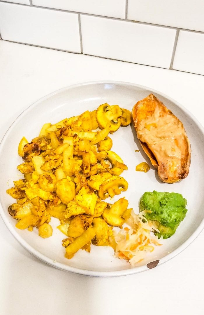 Tofu scramble with sweet potato, avocado and sauerkraut.