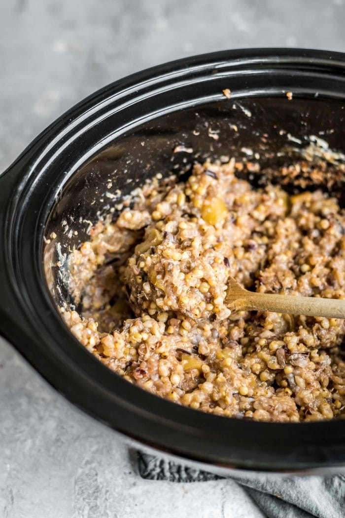 Slow cooker multigrain porridge in a crockpot with apple, banana, brown rice and quinoa.