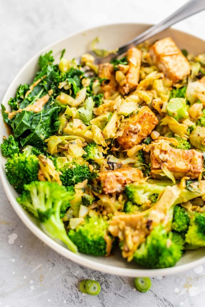 Broccoli with almond butter sauce in a low-carb vegan dinner bowl recipe.
