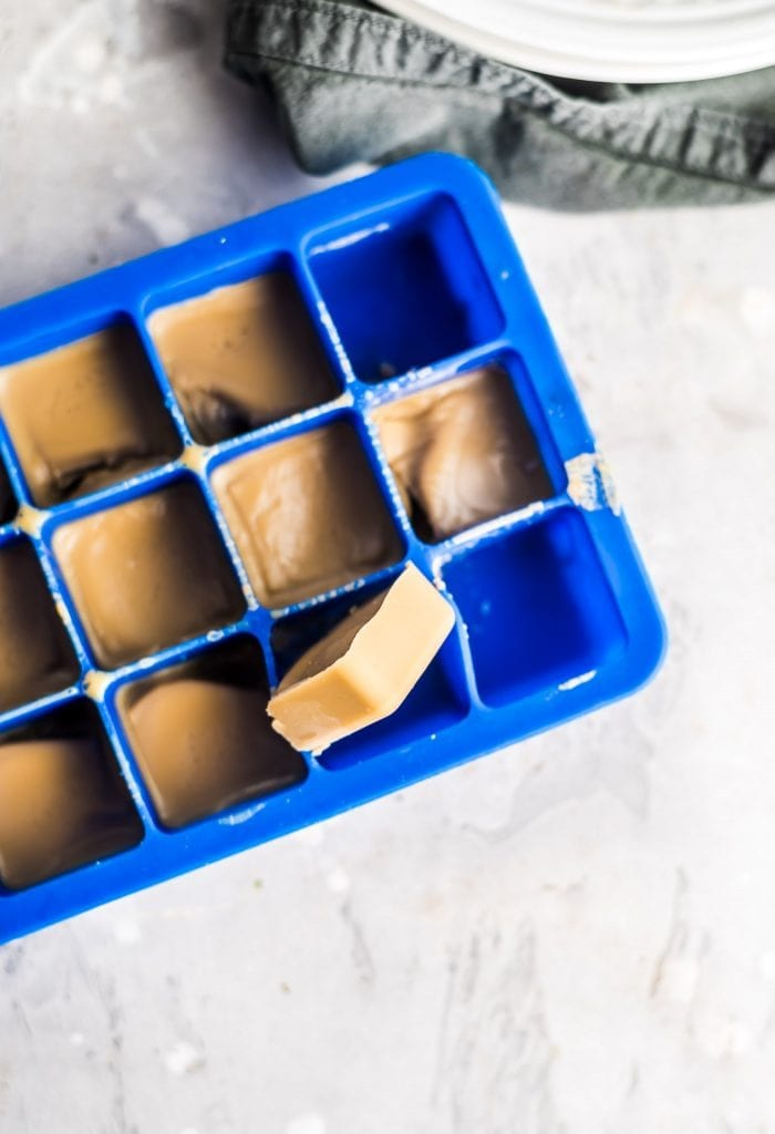 Sugar-free vegan freezer fudge bites in a silicone ice cube tray.