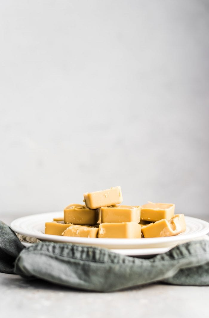 Easy Vegan Freezer Fudge made with Sunflower Seed Butter on a white plate.