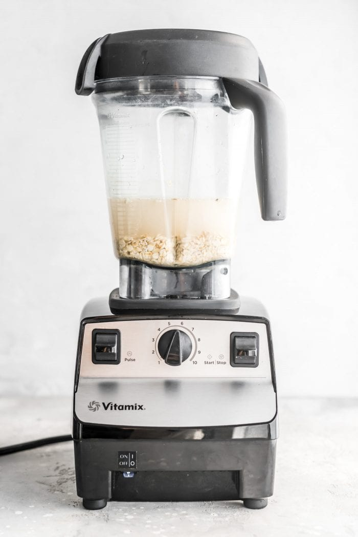 Oats and water in a Vitamix ready to make easy homemade oat milk.