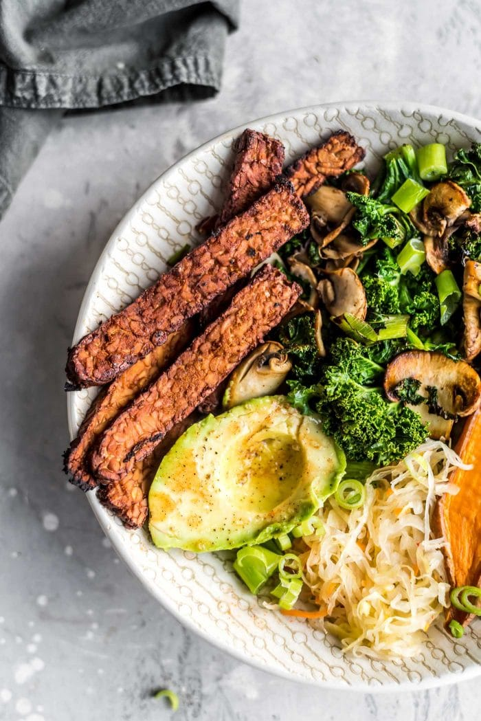 Homemade crispy tempeh bacon in a savory vegan breakfast bowl.