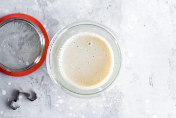 Lemon tahini sauce in a Weck Jar for vegan meal prep.