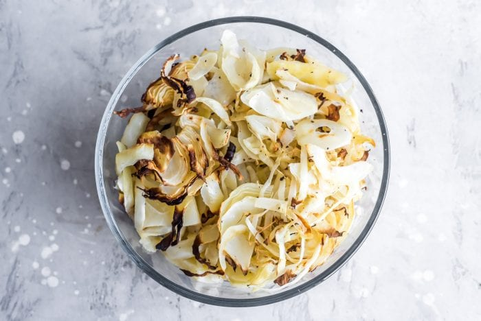 Roasted cabbage in a round glass food storage container.