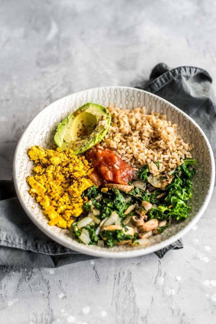 Easy Healthy Savory Vegan Breakfast Bowl with kale, tofu scramble, avocado and brown rice.
