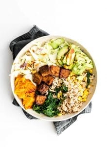 Vegan BBQ tempeh bowls with brown rice, corn and coleslaw.