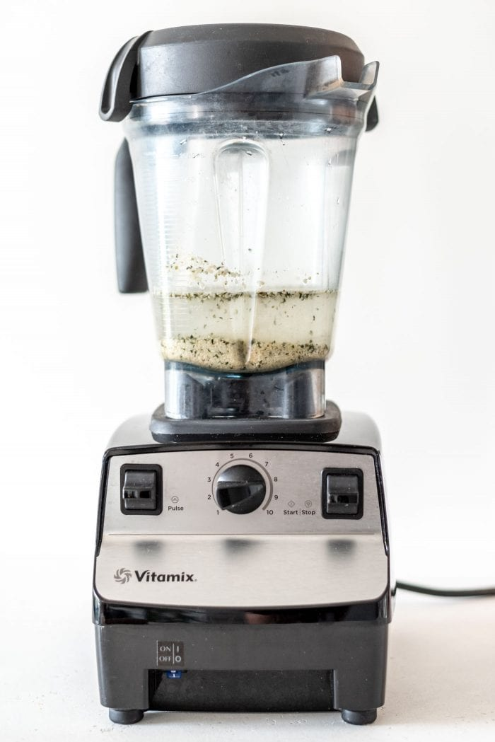 Vitamix blender with water and hemp seeds in it.